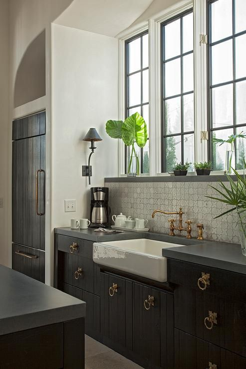 Moroccan Kitchen Features A Alcove Is Filled With Steel Windows Over Black Base Cabinets Topped