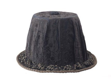 A man s hat with a high crown and narrow brim 968d59cd7b1