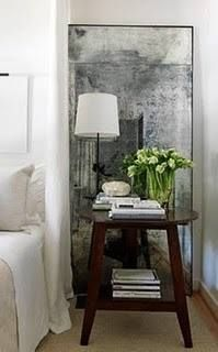 Adore this aged mirror in the bedroom....