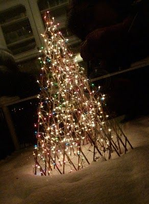 this is a martha stewart everyday from kmart expandable bamboo trellis covered with lights on the deck outside the kitchen window - Kmart Christmas Lights