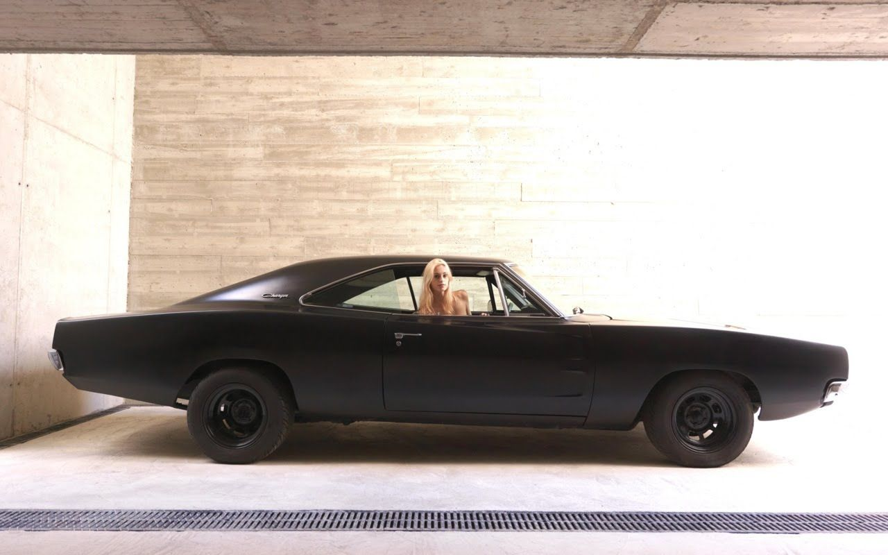 And black & white in a perfect garage.  Dodge Charger.