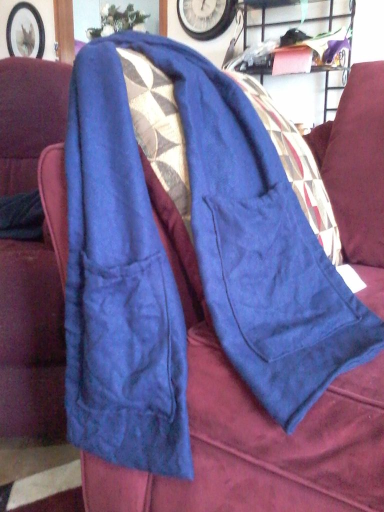 Blanket made into a scarf with pockets. Great for heading out without your purse.