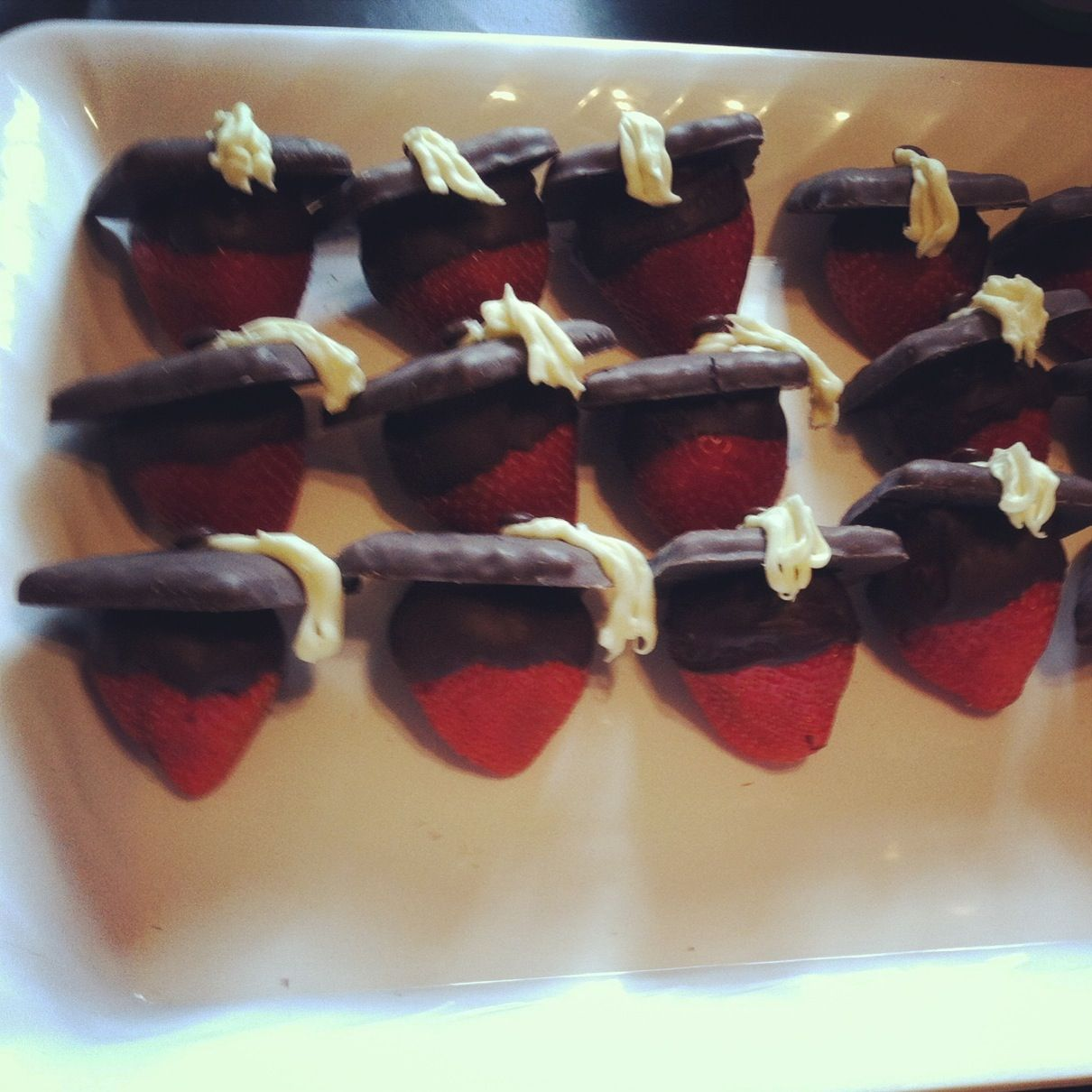 Dipped in chocolate strawberry graduation caps. Cute idea ...