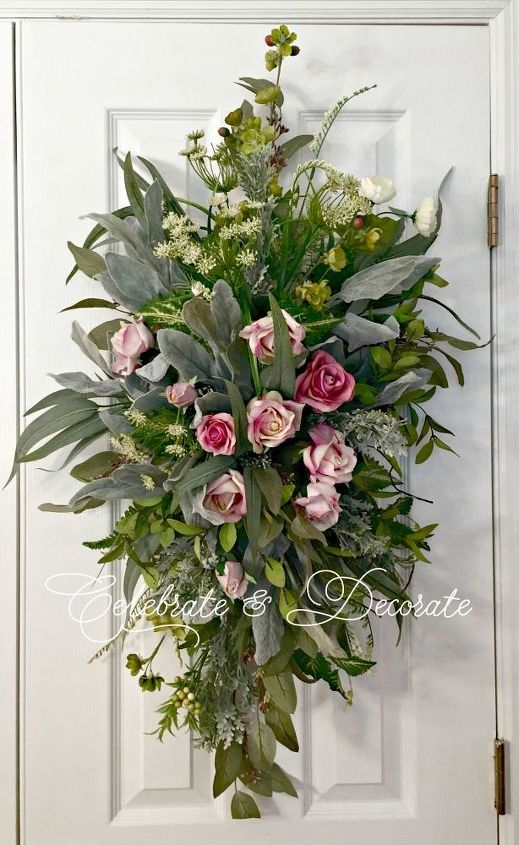 Your front door will thank you for this! I just made this great DIY floral swag. I am sure you get all of those same home decor catalogs I do. I am sometimes taken aback at the prices!