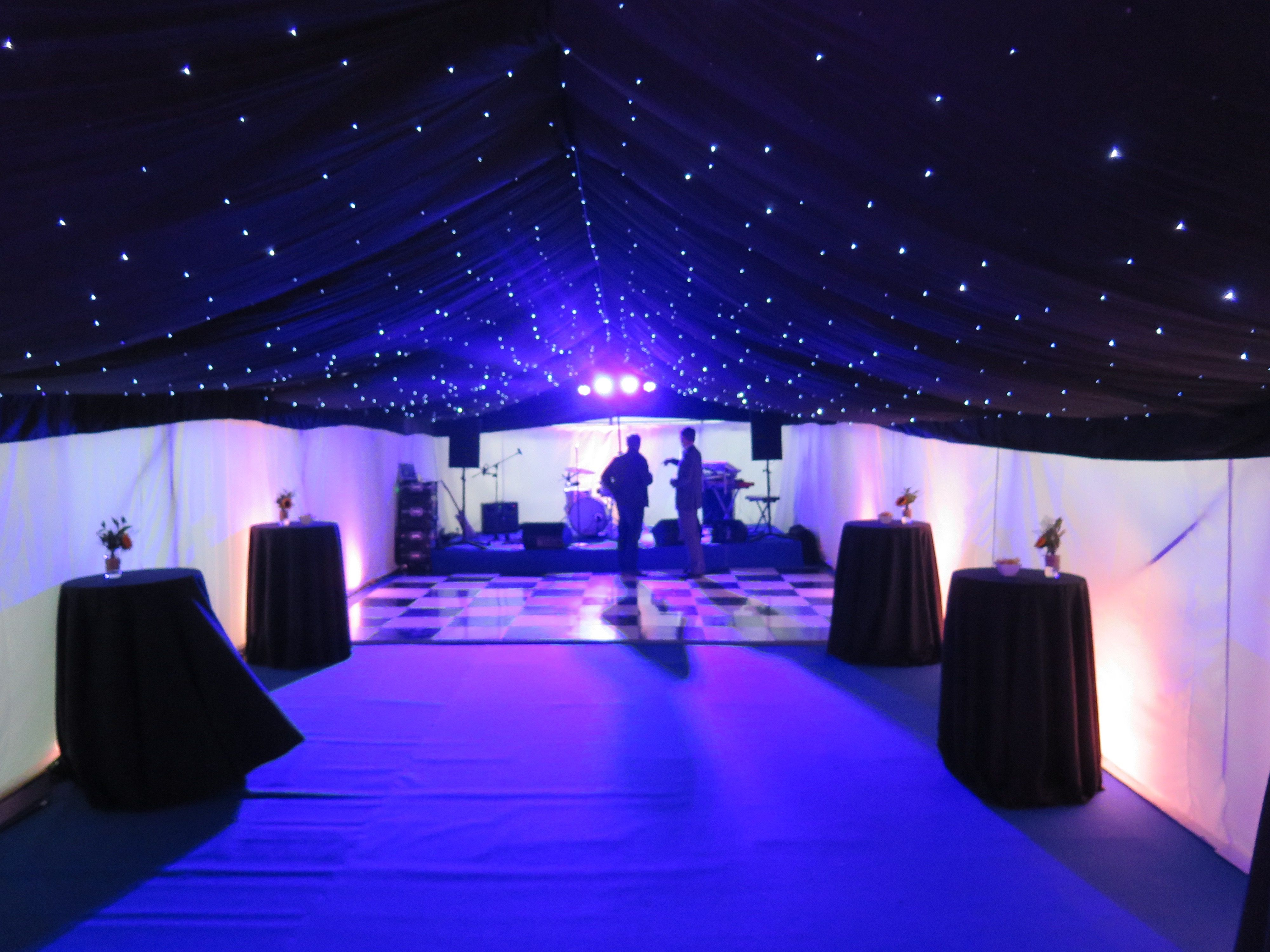 Marquee With Black Star Cloth Roof Lining And White Walls In