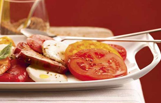 Fresh Tomatoes & Mozzarella Cheese | Serve summer's favorite vegetable thickly sliced and flavored with Mrs. Dash® Tomato Basil Garlic Seasoning Blend. Add fresh mozzarella and your homemade oil and vinegar dressing for a refreshing bite.
