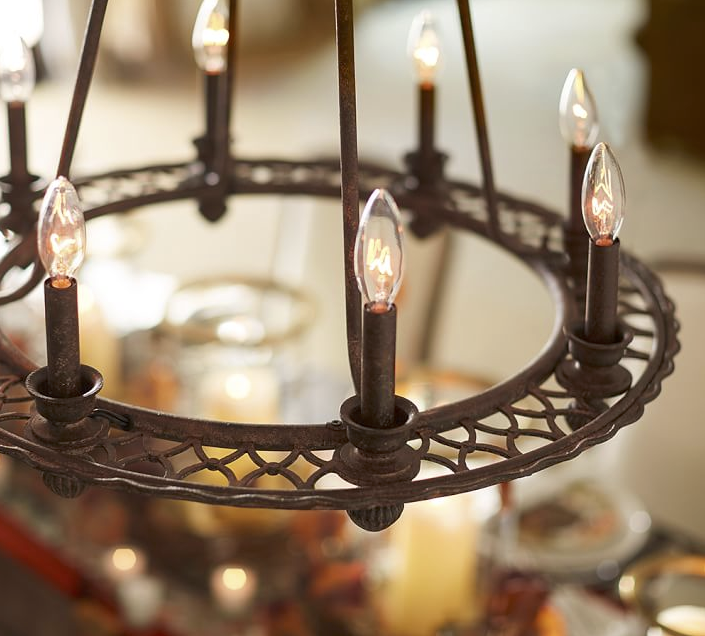Fashioned after a vintage find at a flea market, our chandelier brings a rustic yet graceful quality to a room. A lacework pattern on the iron frame adds to its distinctive look.