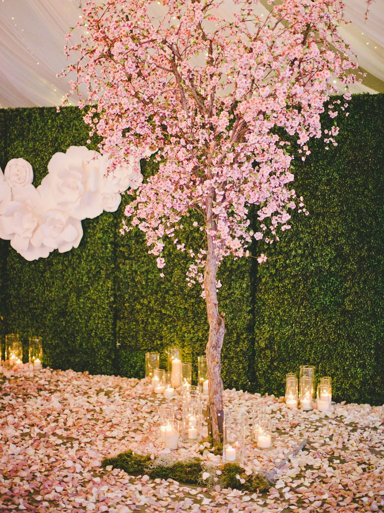 11 Romantic Ways To Fill Your Wedding With Candlelight Blossom Tree Wedding Cherry Blossom Wedding Theme Cherry Blossom Theme