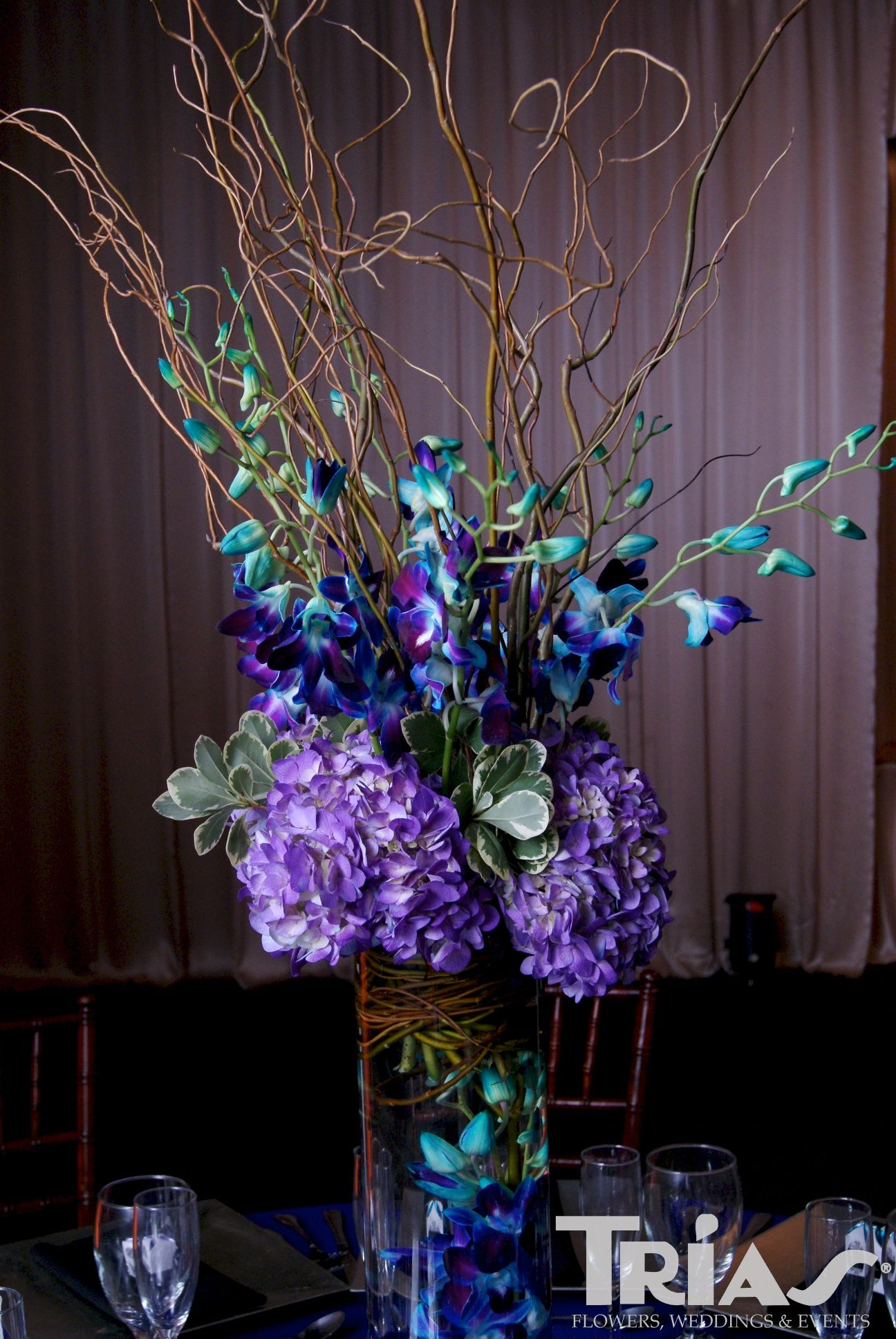 Purple Centerpiece Accented With Blue Wedding Floral