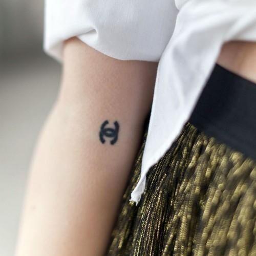 tiny chanel tattoo