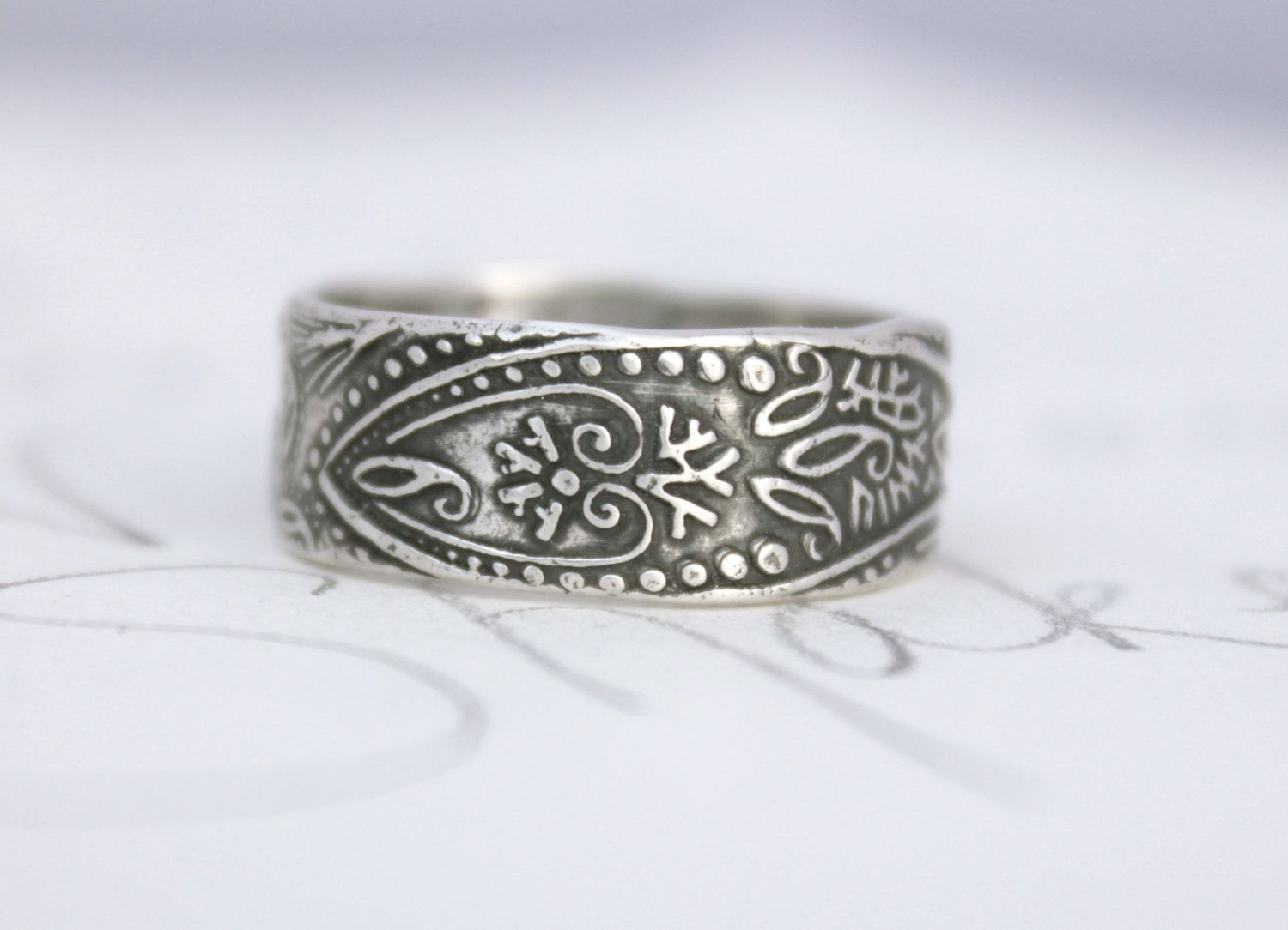 wide mens wedding band . recycled silver paisley ring . engraved custom ring . bohemian mens ring ready to ship size 7 1/2. $194.00, via Etsy.