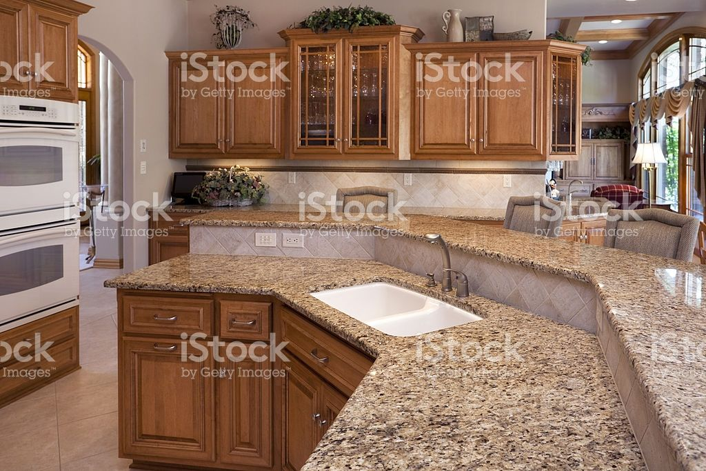 custom luxury eat in kitchen with granite counters oak cabinets