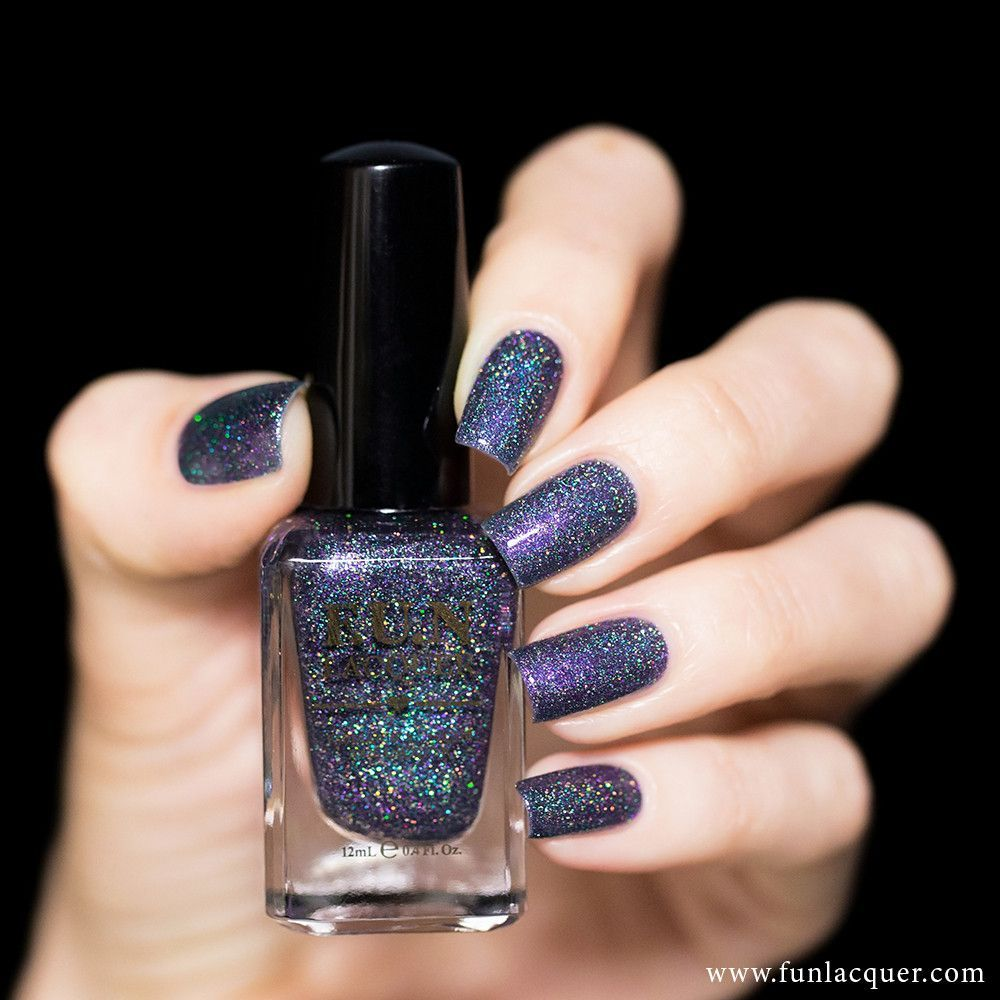 This holographic purple nail polish with touch of grey and gold ...