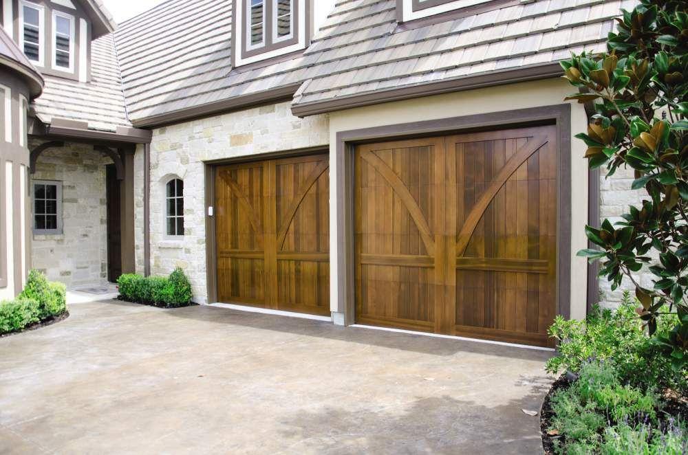 Beautiful Wood Garage Door Signature Carriage Custom Design Learn More At Overheaddoor C Custom Wood Garage Doors Carriage House Doors Wood Garage Doors