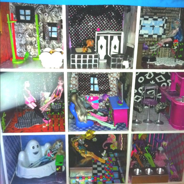 Monster high dollhouse made from cube organizer and scrapbook paper (if my daughter didn't have a doll house) revamp ideas for sure. :)