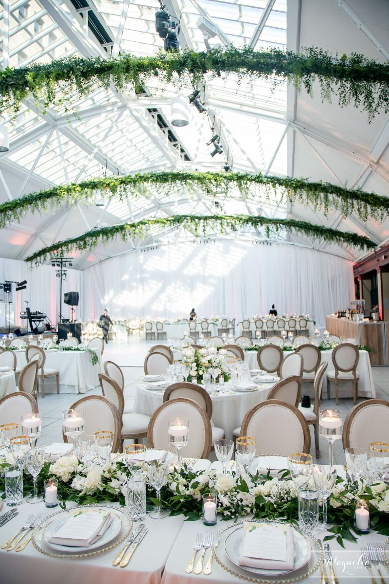 From the grand greenery arch at the ceremony to the hanging greenery ...