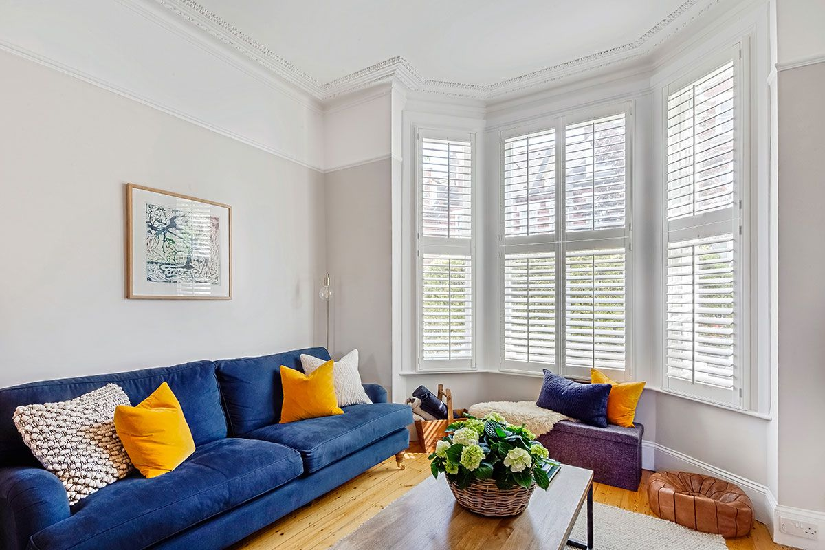 Sophisticated Shutters Compliment Colourful Bursts In Brockwell In 2020 Interior Design Degree Affordable Interior Design Best Interior Design Websites #shutters #in #living #room