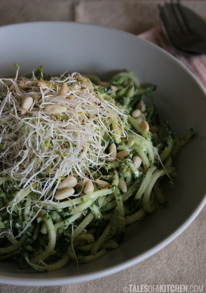 Zucchini noodles with kale pesto, sprouts and pine nuts.