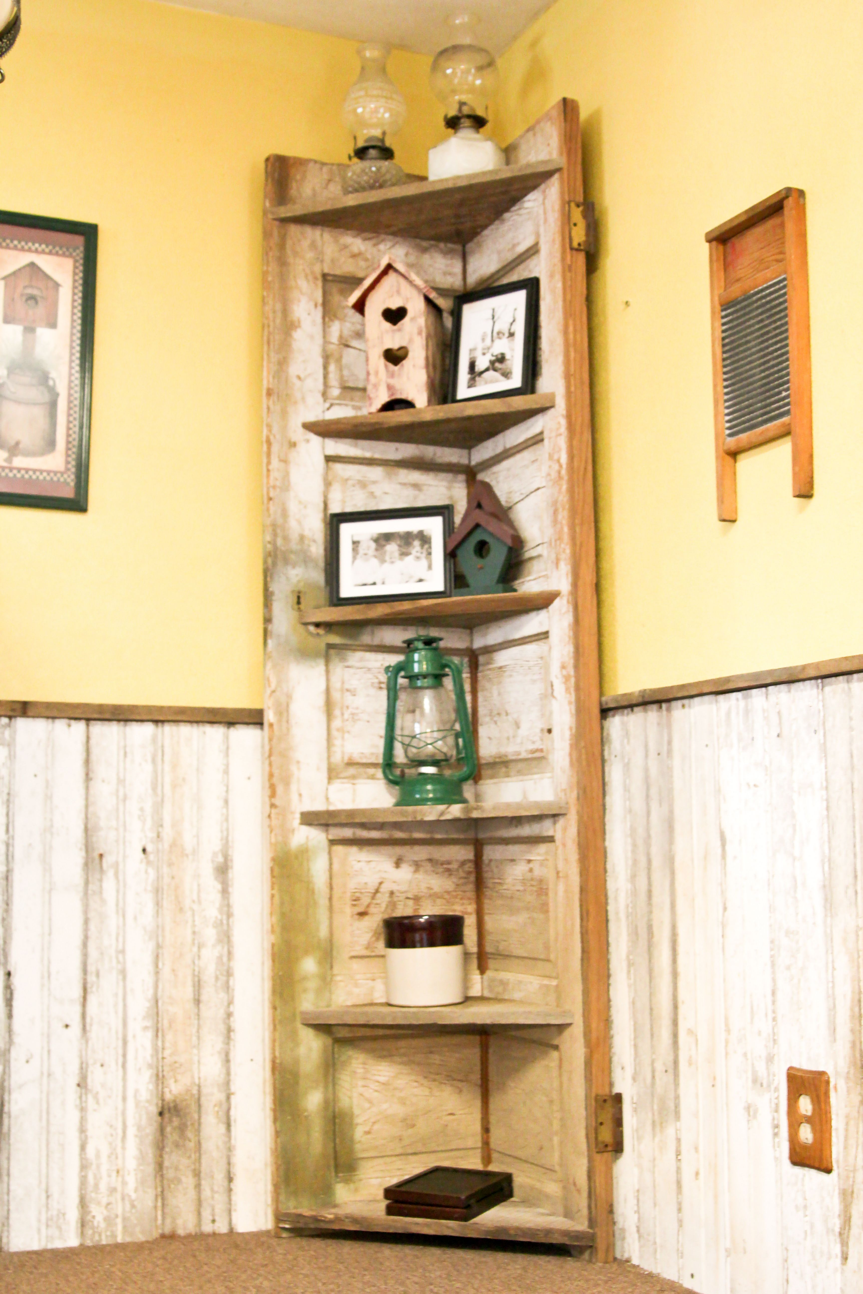 A old door made into a rustic corner shelf for my kitchen Corner shelf ideas