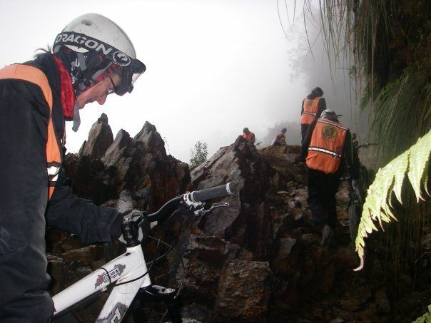 """climbing over jagged rocks while biking the """"World's Most Dangerous Road"""" in Bolivia #biking #Bolivia #mountain #adventure #dangerous  http://sorryimnotsorryblog.com/that-one-time-i-was-rescued-off-a-mountain-face-by-bolivian-swat/"""