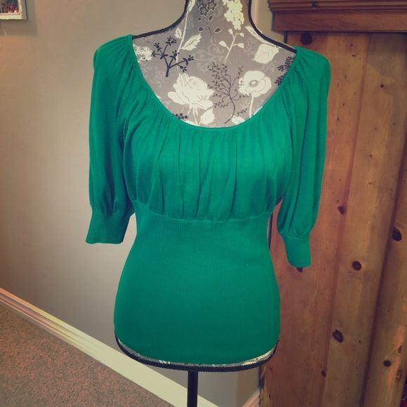 Gianni Bini green shirt size M Gianni Bini green shirt size M. Very flattering knit shirt that pairs perfectly with dress pants or Levi's. Been worn only a few times so in great condition. Gianni Bini Tops Blouses