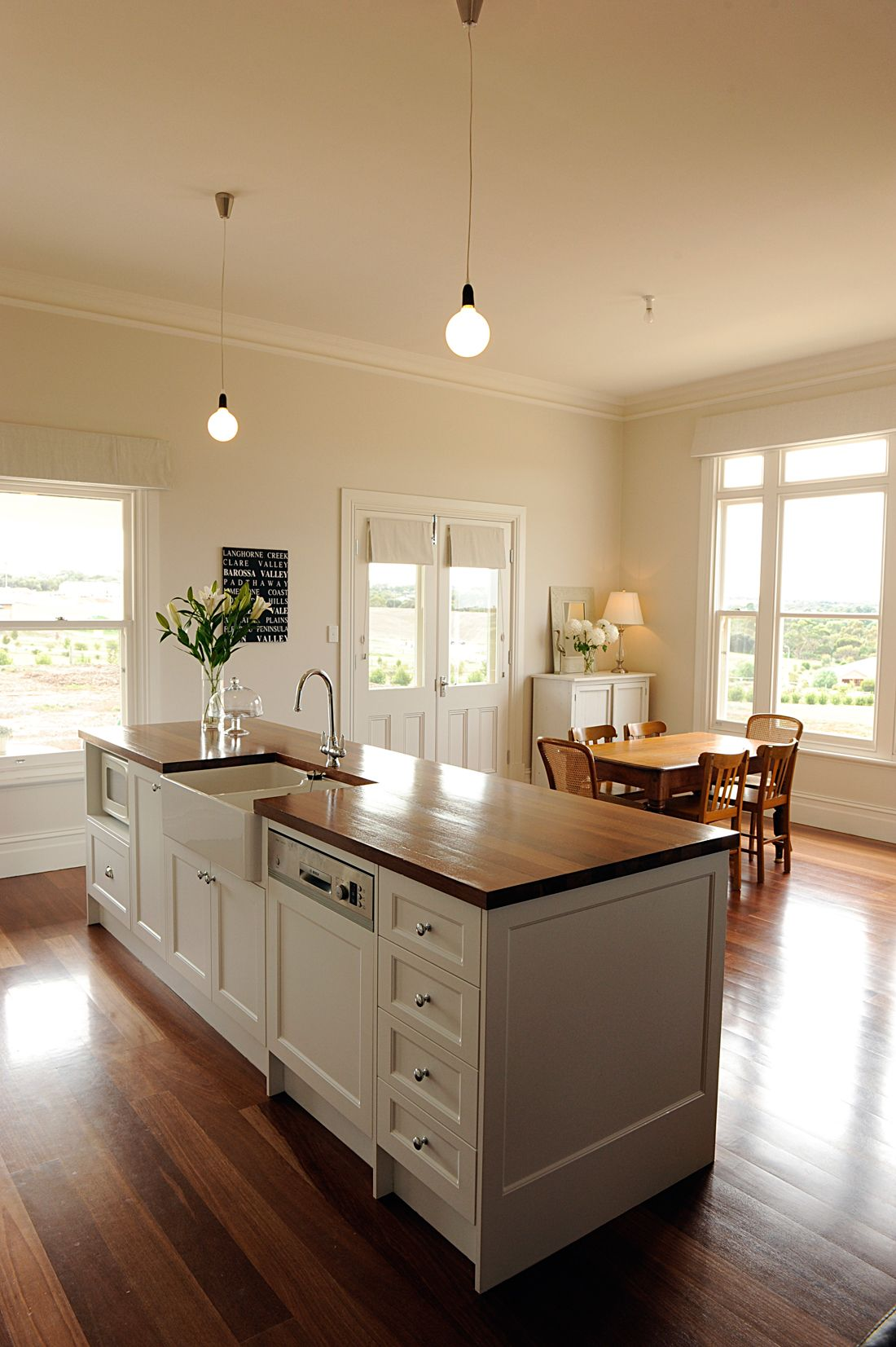 I have the same cabinetry now though with a caesarstone - Kitchen island with sink and dishwasher and seating ...