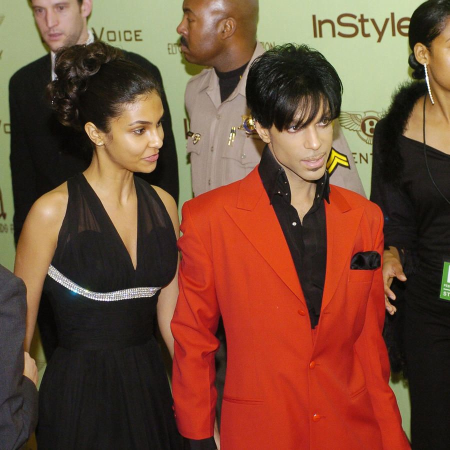 Prince, center, arrives with a guest Feb. 29, 2004, at the 12th annual Elton John AIDS Foundation Fundraiser and post-Oscar party in West Hollywood, Calif