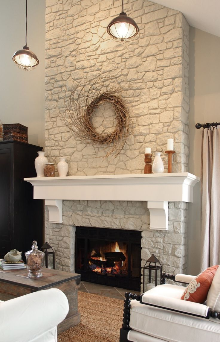 Paint fireplace rock out white add reclaimed wood mantle or