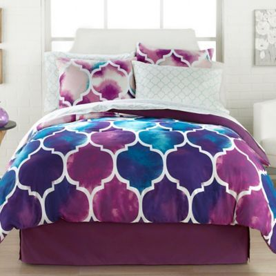 your space with the vibrant watercolor print of the emmi comforter set decked out in a largescale trellis pattern in bold blue purple