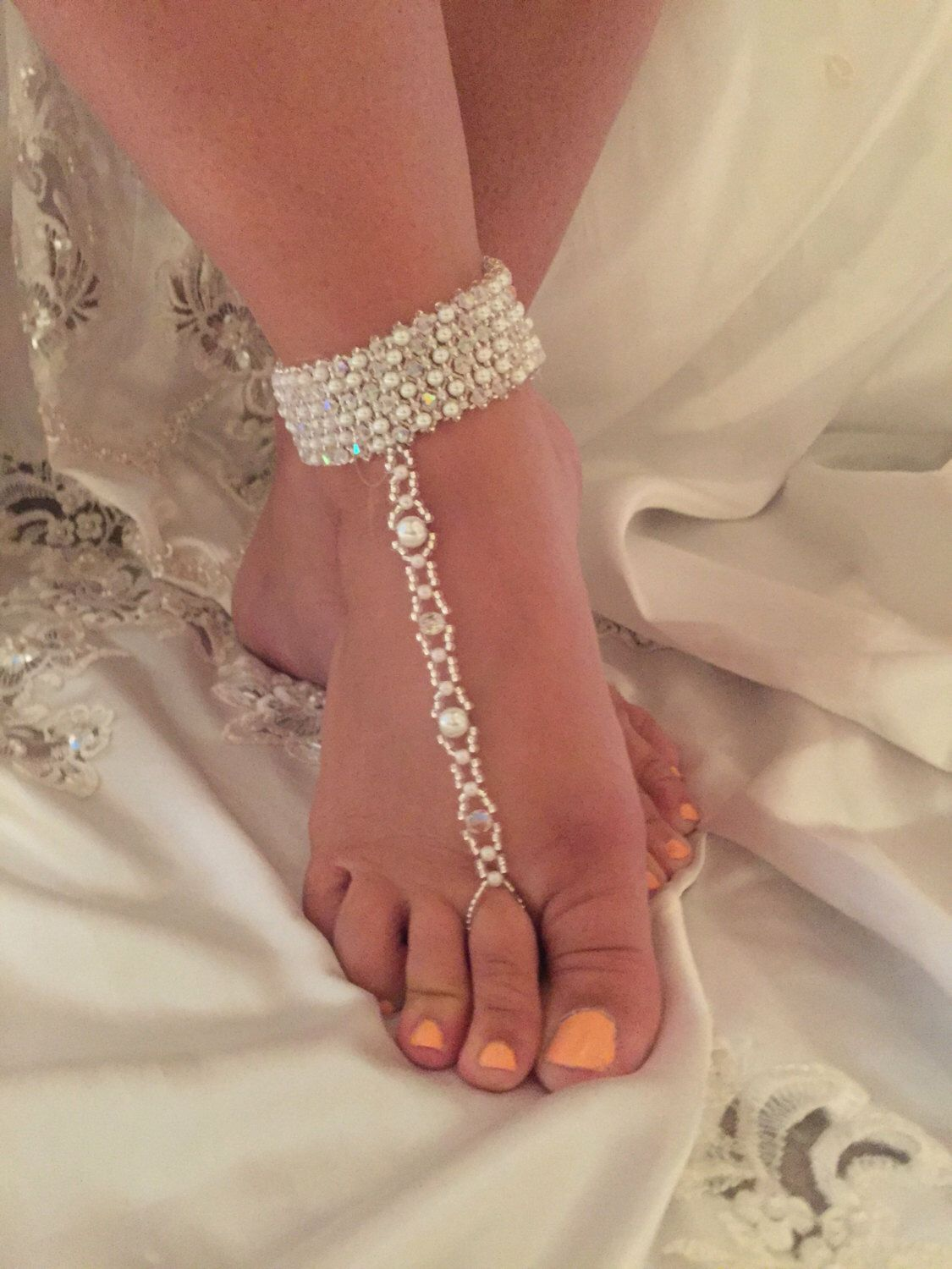 A personal favorite from my Etsy shop https://www.etsy.com/listing/450643408/barefoot-wedding-sandal-ankle-band