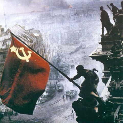 Soviet soldiers raise a flag