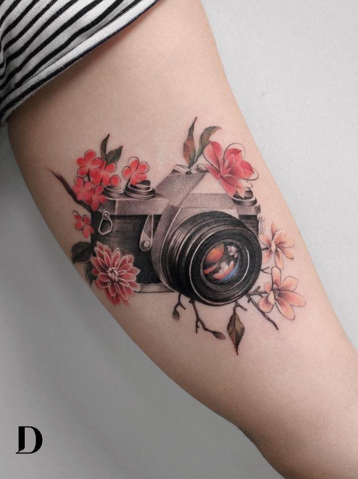 100 Best Tattoos Of All Time Thetatt Camera Tattoos Camera Tattoo Design Shape Tattoo