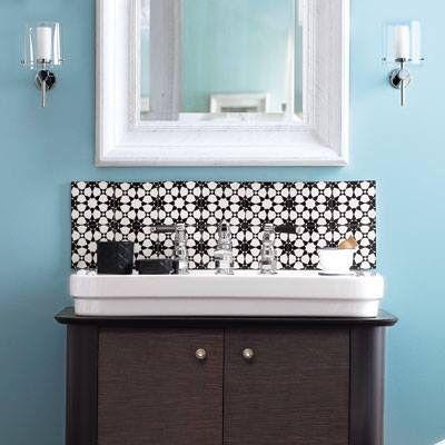 black-and-white tile backsplash in the bathroom