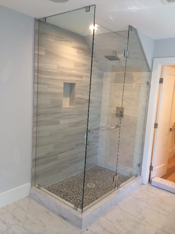 Installed a custom 90 degree shower enclosure with a angle cut panel ...