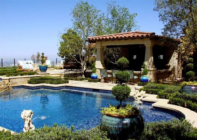 spanish style frontyard ideas this resort like backyard features a swimming pool with a