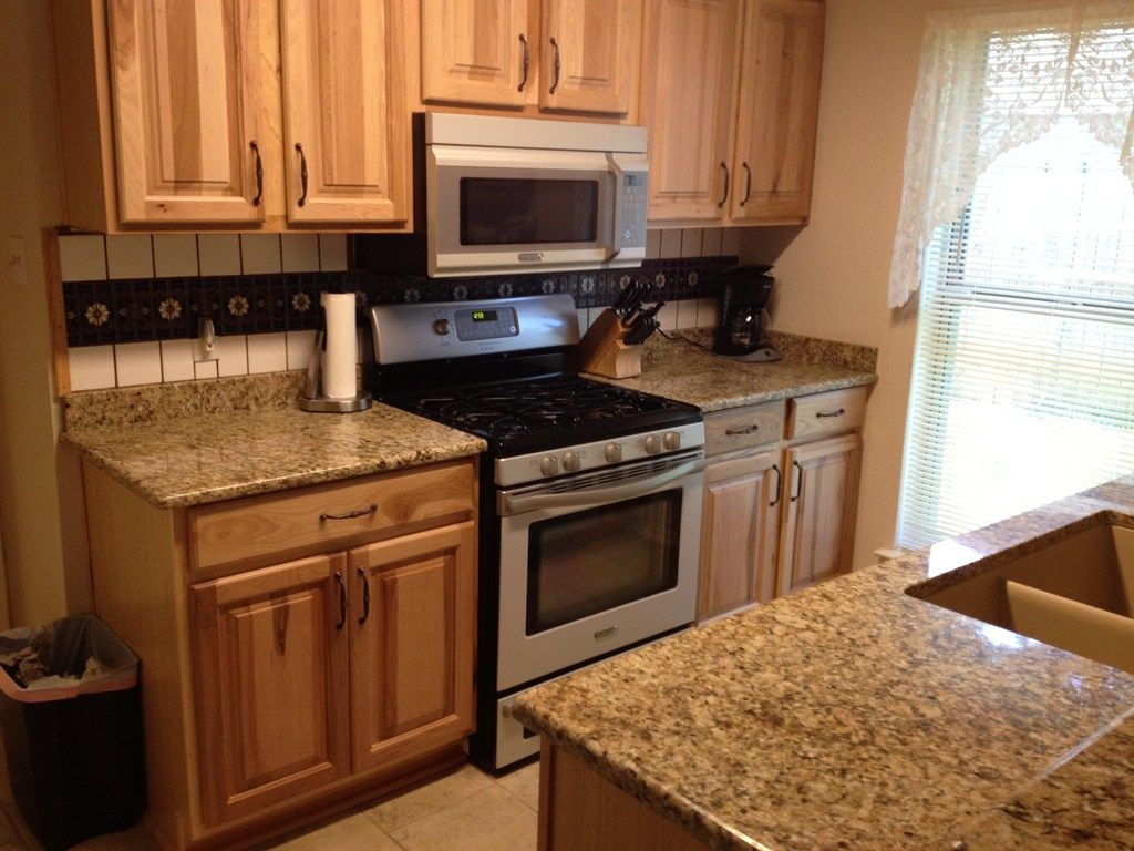 Honey oak cabinets with black granite countertops google for Dark oak kitchen cabinets