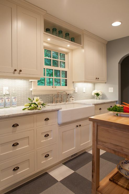 Gorgeous gray and ivory kitchen features white cabinets for White bathroom cabinets with bronze hardware