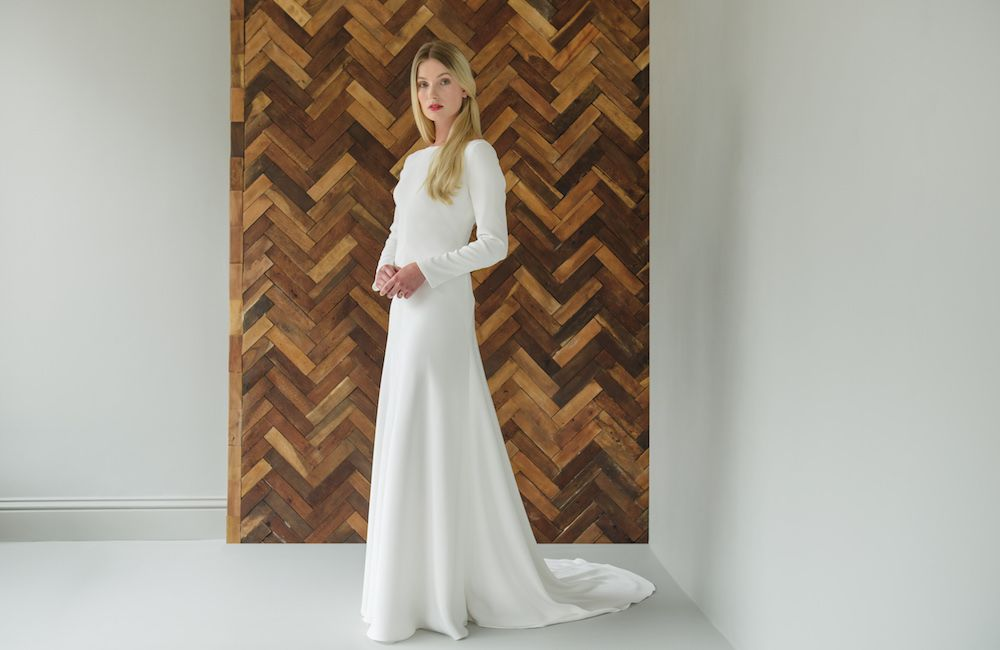 Elegant long sleeved wedding dress by Andrea Hawkes
