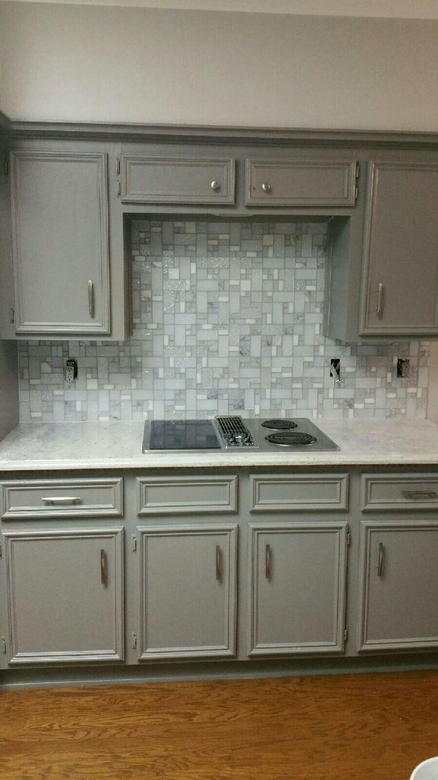 Glass mosaic backsplash and granite counter top.