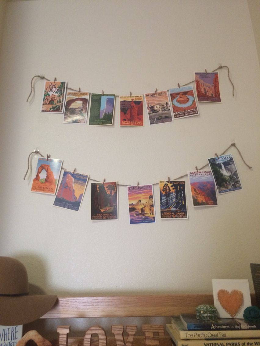 Use twine and mini clothes pins to hang up pictures or postcards. This is a