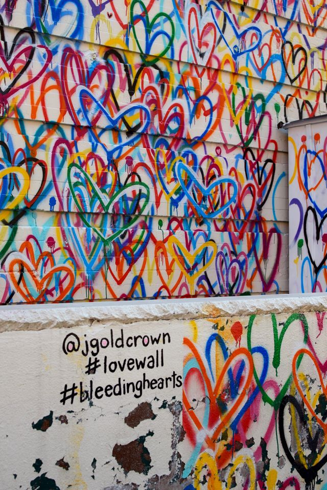 Nyc street art bleeding hearts by james goldcrown for Mural on broome street