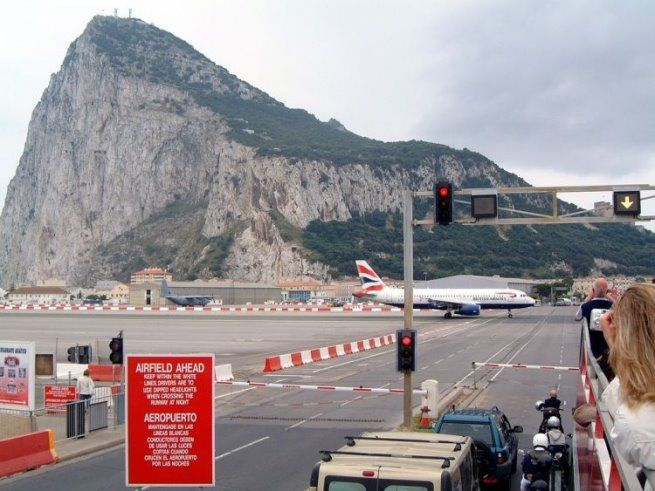 Car traffic stopped for airplane at Gibraltar Airport