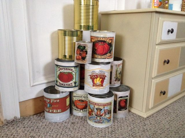 Large cans decopaged to be used as planters