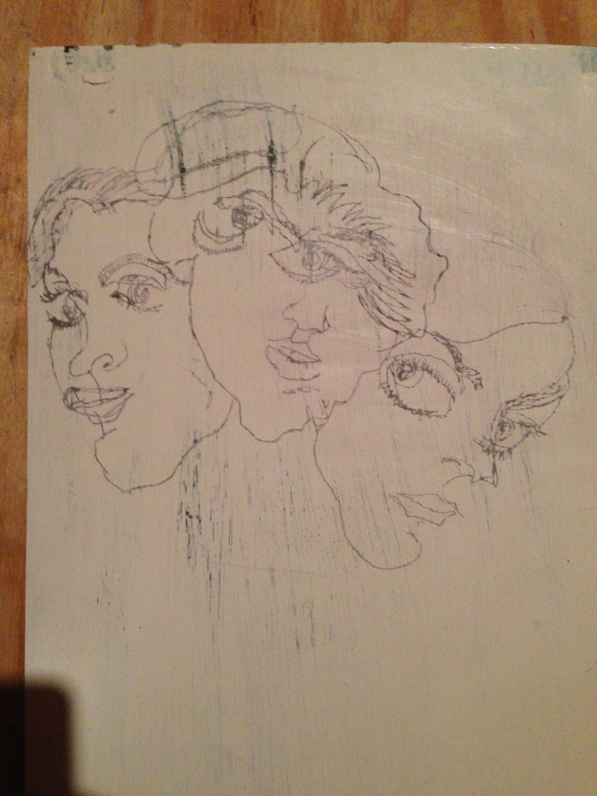 Blind drawing of myself from three different angles.