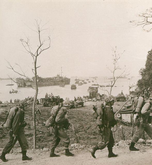 Marines moving off the beach at Okinawa