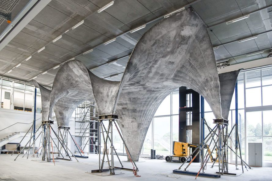 New Concrete Roof Includes Thin Film Pv Cells To Generate Power Concrete Roof Concrete Structure Concrete Architecture