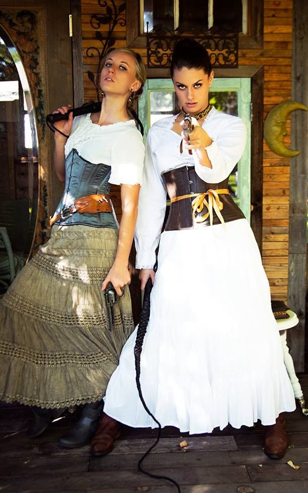 """What you lookin' at?"" Don't mess with these ladies! Corsets, guns and a whip-look out!"