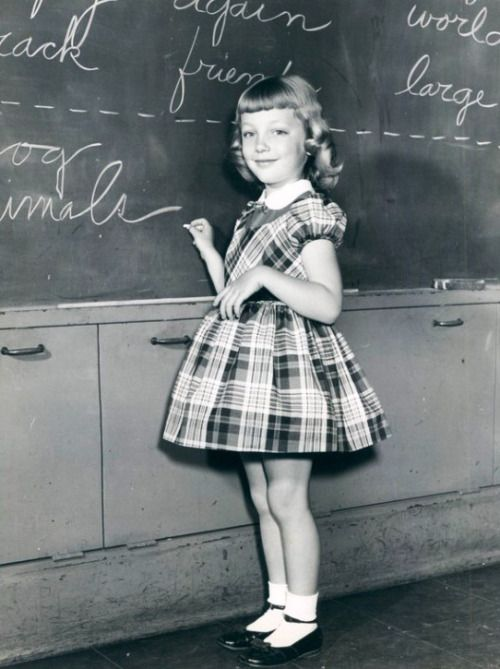 f514c556fd36 All children liked writing on the board. This little girl has the ideal  1950s dress with crinoline under, sweet socks and Mary Jane shoes.