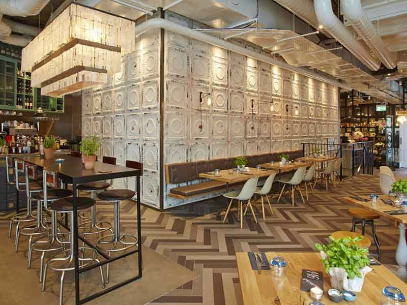 contract furniture specialist andy thornton supplied restaurant furniture bar furniture and metal tiles to create a striking feature wall for new bar and