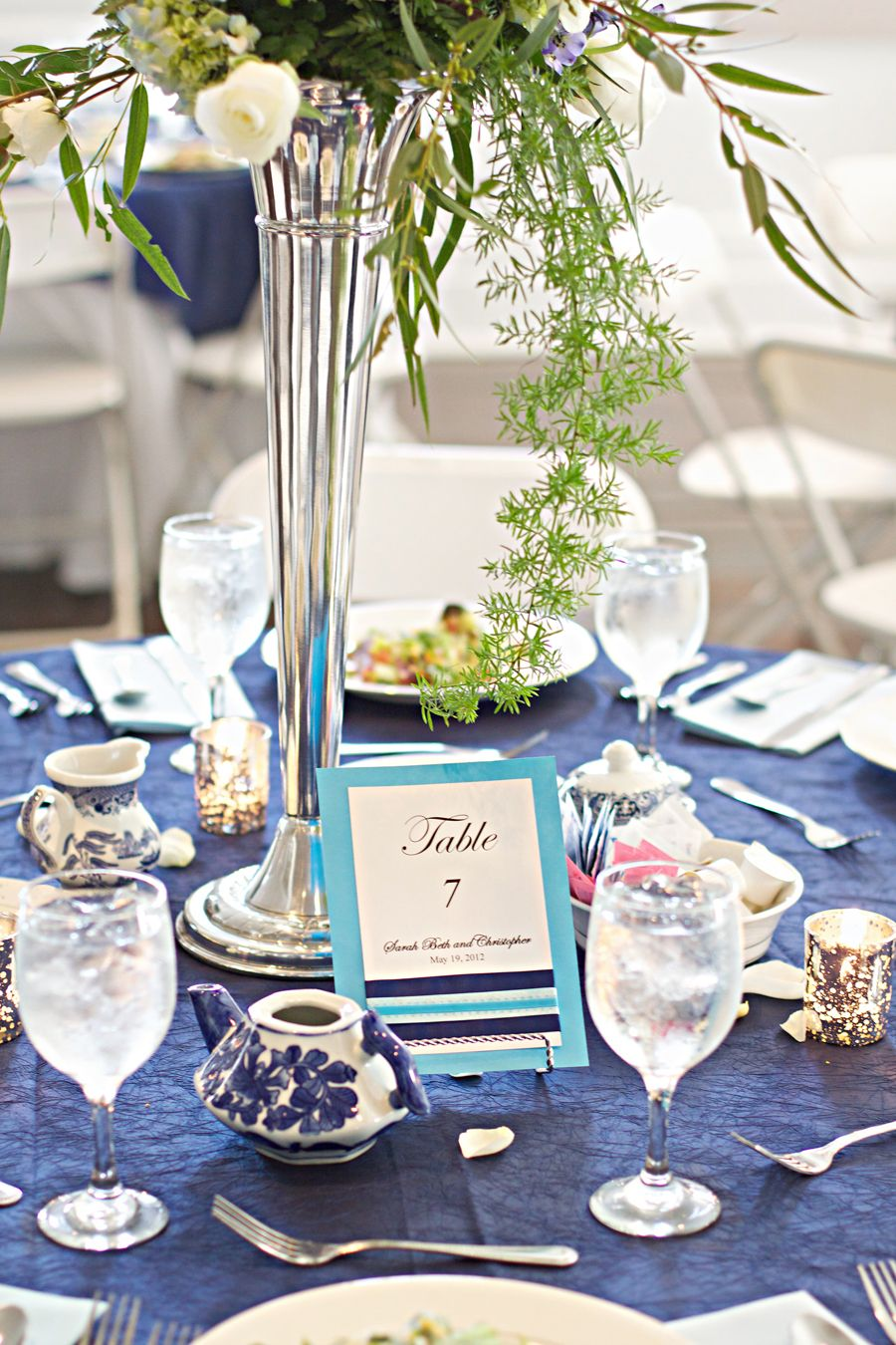 Blue and white reception each table reflected the
